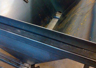 Slide-in gravel hopper with an auger bottom for a 1-ton dump.