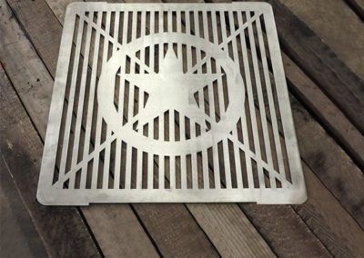 The star grill is available in stainless or steel and can be used over a fire pit or fire ring.